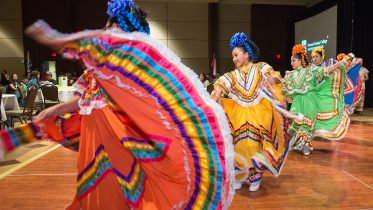 Dancers swirling colorful skirts