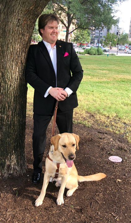 Ryon Anderson by tree with dog
