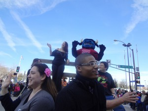 Picture of students riding float with Toro.