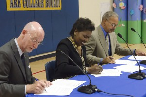 UT Arlington Vice Provost for Academic Analytics and Operations Dale Wasson, TCC Chancellor Erma Johnson Hadley and Fort Worth ISD Superintendent Walter Dansby sign the Nash Academic Challenge Renewal Agreement