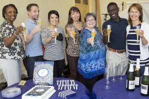 Members of the REACH editorial team raise a toast to the launch of the inaugural issue.  (L-R: Rita Parson, Brandon Tucker, Sara Rogers, Connie Wiebe, Kendra Prince, Terrance Gilbert and DeeDra Parrish