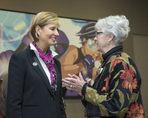 TWU Chancellor and President Carine Feyten, left, speaks with TCC Trinity River Campus President Tahita Fulkerson.