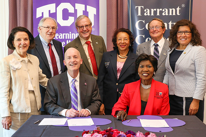 TCC Board members flank TCU Chancellor Victor J. Boschini Jr.,  seated left, and TCC Chancellor Erma Johnson Hadley.  TCC board members from left to right are: Board President Louise Appleman,  O.K. Carter, Conrad Heede, Gwen Morrison, Bill Greenhill and  Teresa Ayala.