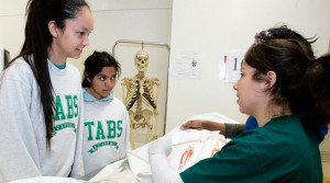 Rachelle Wanser (L) and Rio Velasquez learn about the anatomy of a cadaver frpm UNT Health Science Center.