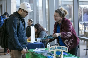 A TCC student talks with a University representative during the Transfer Fair.