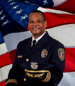 Chief Williams w flag backdrop