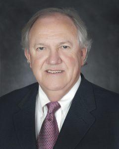 Portrait headshot of Board member OK Carter.