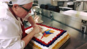 Alison Hodges decorates cake